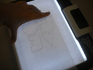 Photo 5: Place the LOVE template on your lightbox or window.