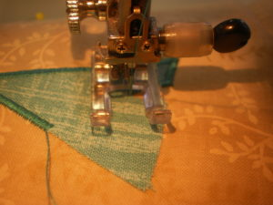 When stitching an internal point – stitch all the way along the edge prior to the point, leave the needle down on the right, lift the foot and turn your work so the needle is parallel to the point. Put the foot down and make 2-3 stitches in the centre of the point. Leave the needle down on the right side, lift the foot and turn your work, lining up the next edge.