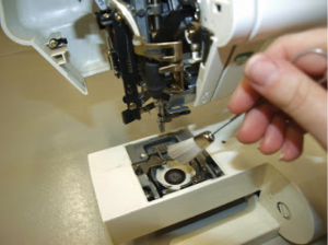 Turn the machine back up and use a small brush to remove any more dust you can see.