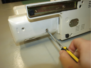 Lie the machine back down and reattach the cover plate.