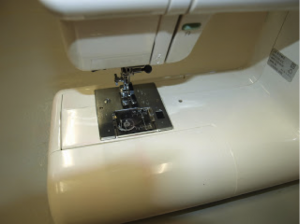 Pop the storage tray back on. Rethread the machine, power up and  test your stitches and tension. Then back to work!
